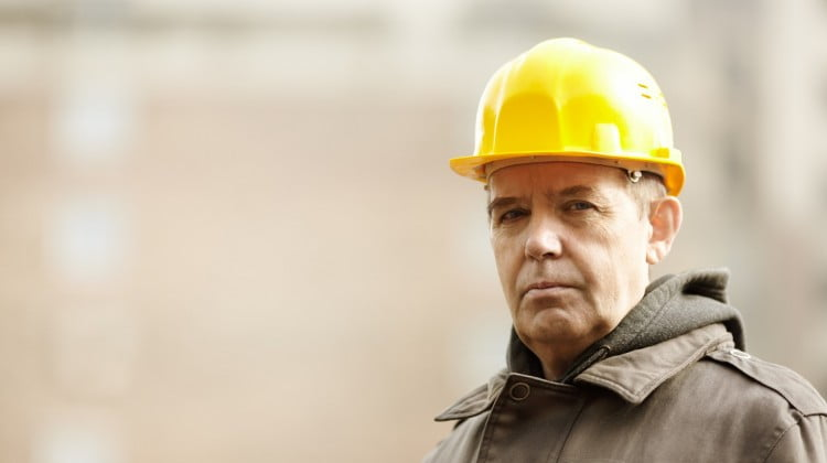FIFO workers doubled risk of depression: older man in yellow hard hat looking wistful