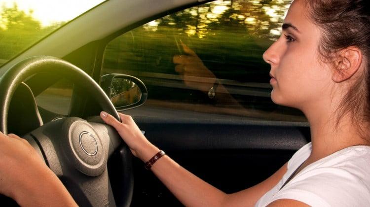 sleep guidelines: teenage girl behind the wheel looking nervous