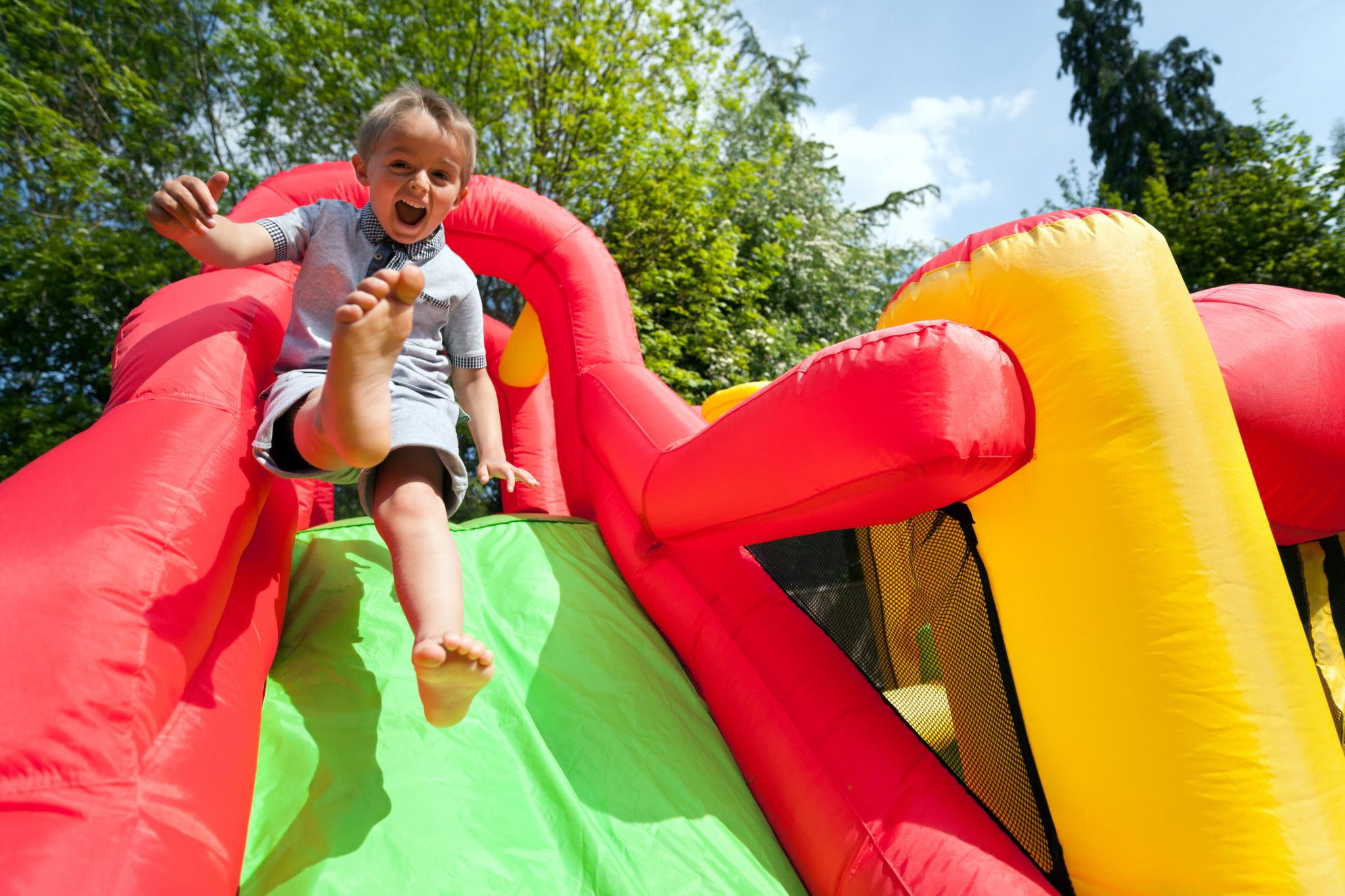 Heart Foundation: little boy sliding down bouncy castle ramp