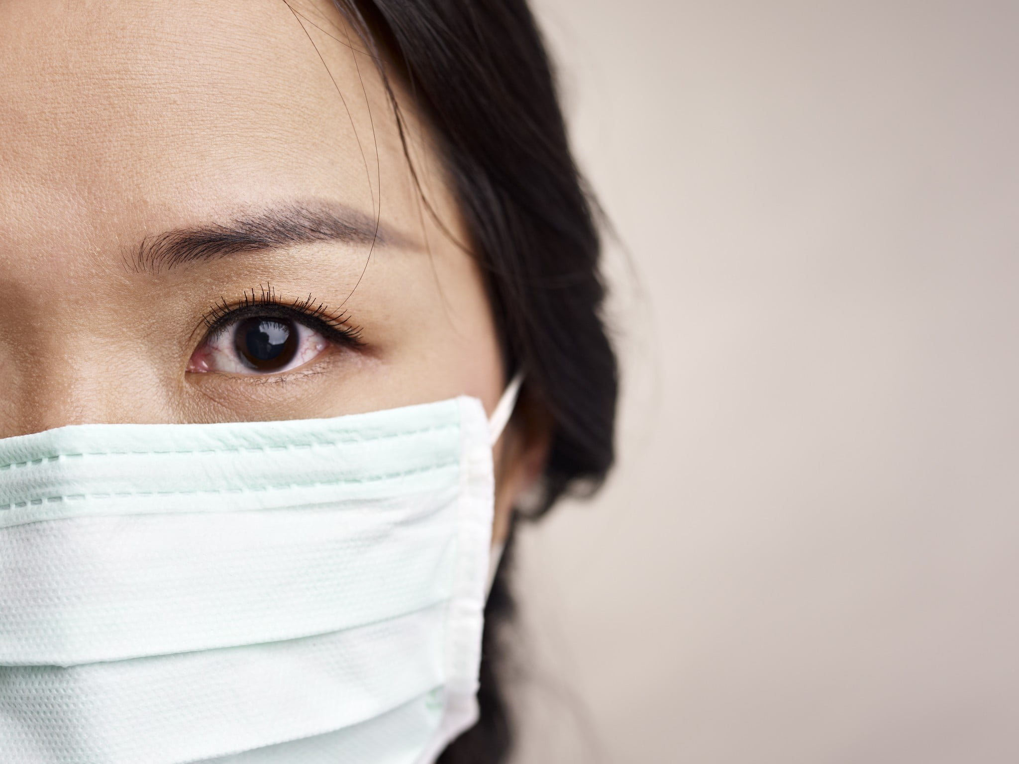 MERS concept: woman in hygiene mask