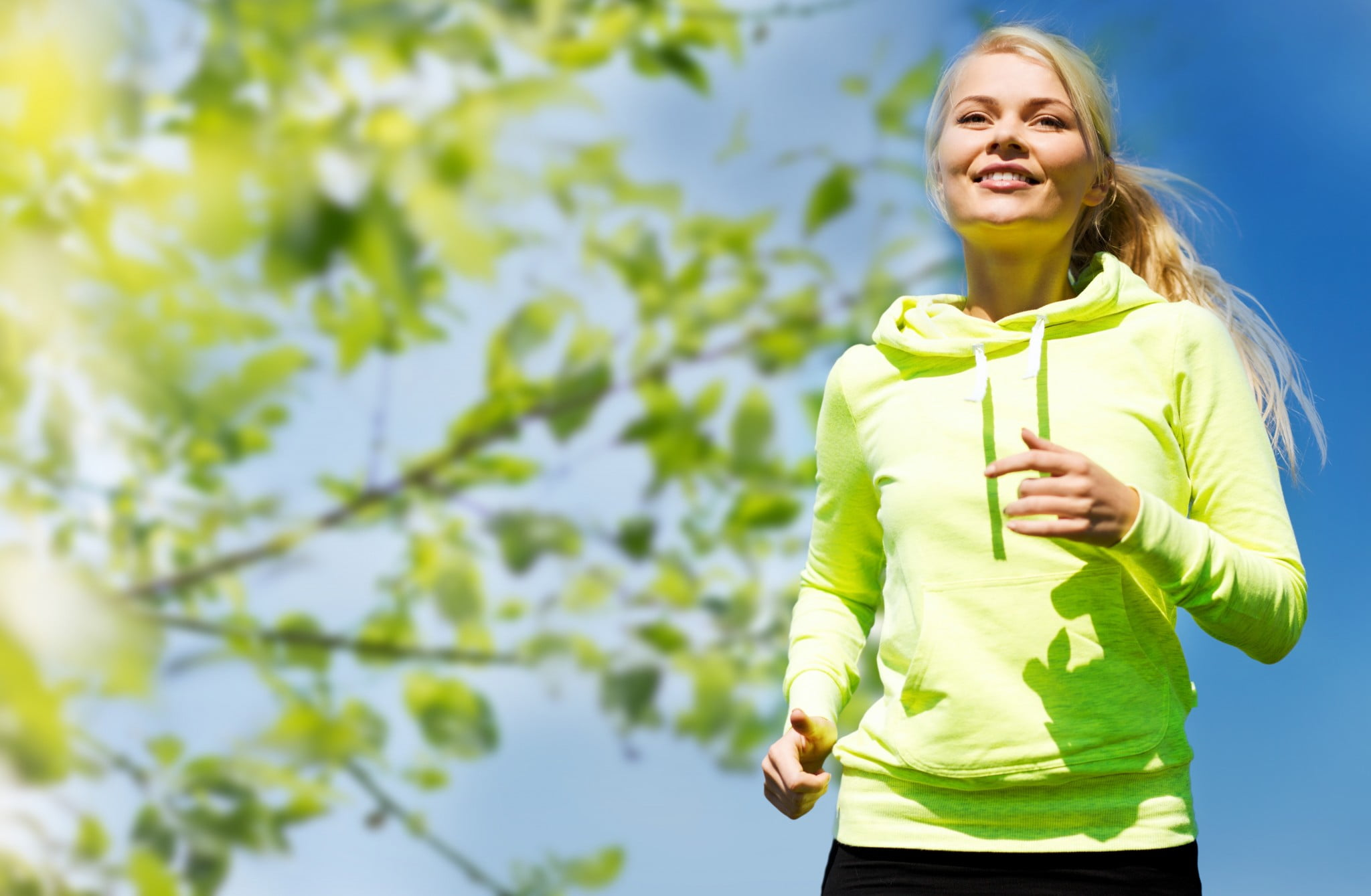 Go red for women: young woman jogging outdoors