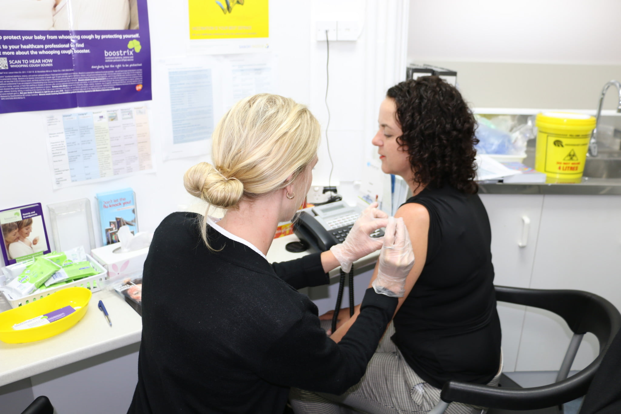 down-scheduling: Natalie Gauld being vaccinated in pharmacy