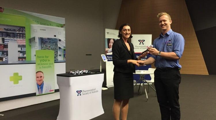 Samuel Turner receives his award