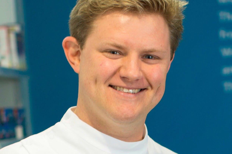 Bruce Elliot headshot, smiling