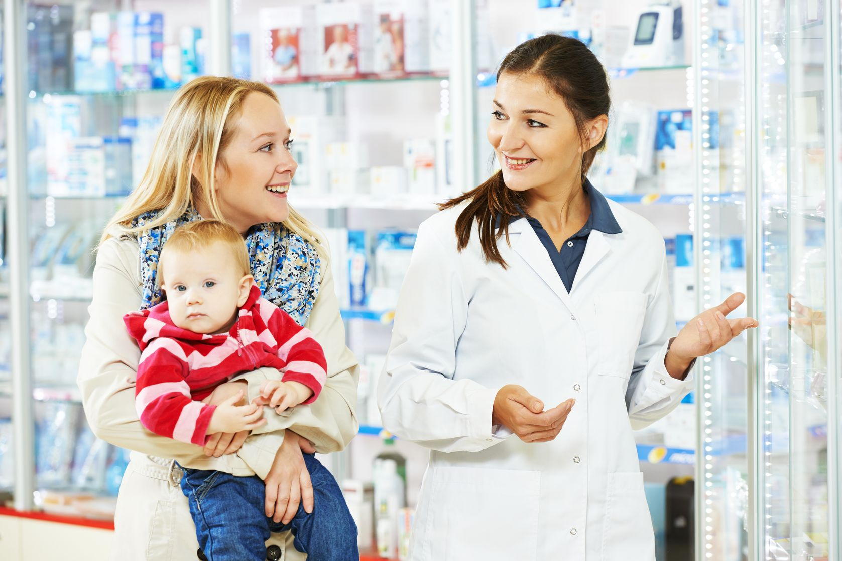 women in pharmacy: pharmacist with a woman with baby