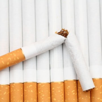 quit smoking: rows of cigarettes with one broken