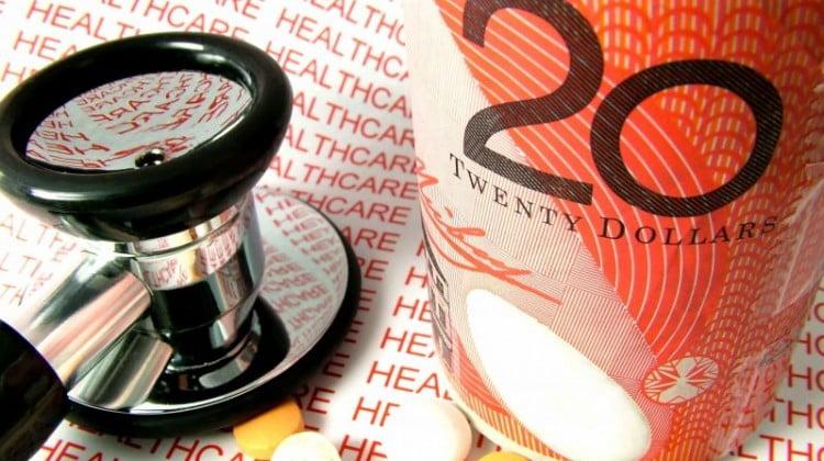 pharmacies better value: $20 note, pills, stethoscope