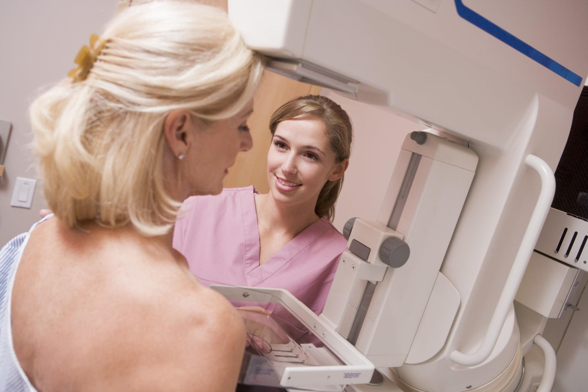 breastscreen: woman having mammogram