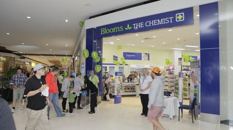 Blooms the Chemist shopfront, celebrating