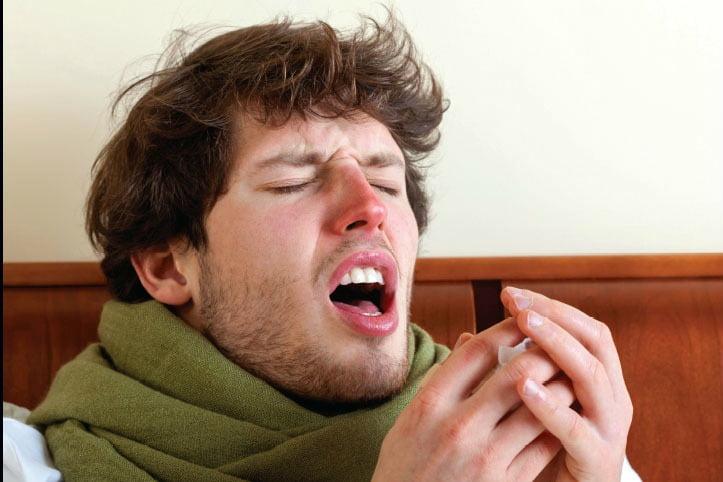 sneezing billboards image: young man mid-sneeze