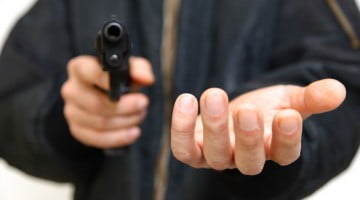 robber with handgun