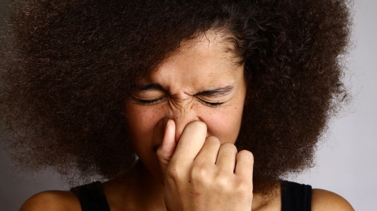 woman sneezing - cold or allergy
