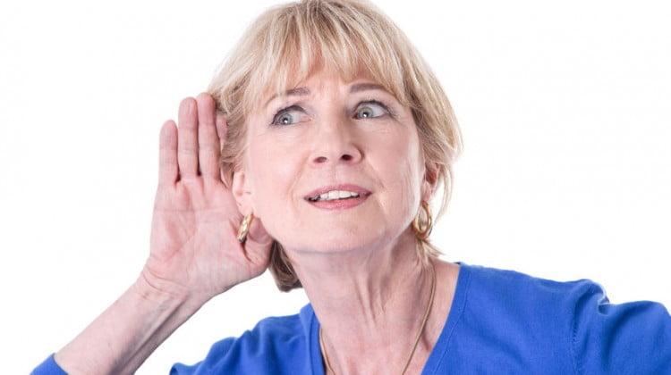 hearing - woman cups ear