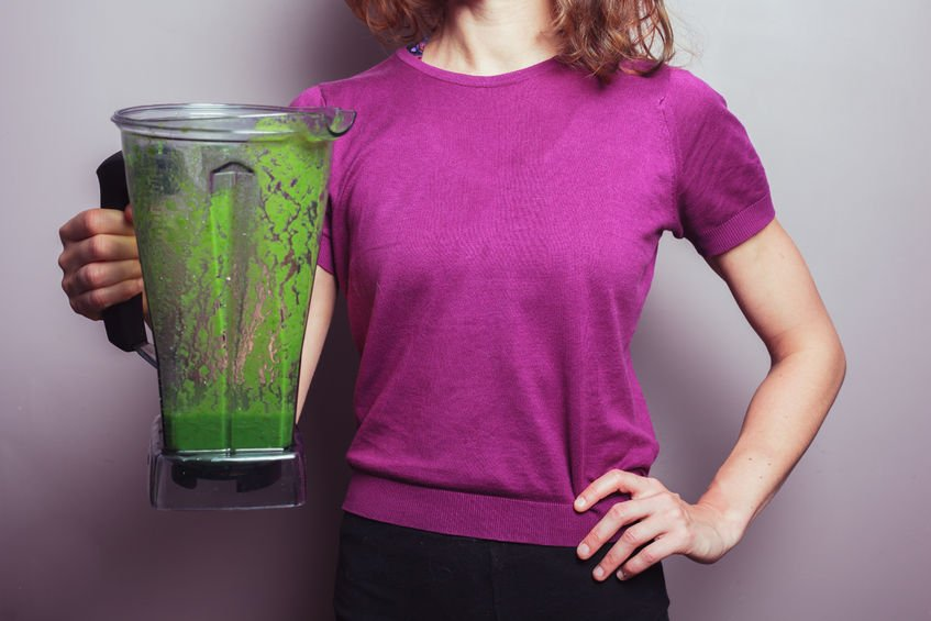 woman with pitcher of unpleasant green dietary cures