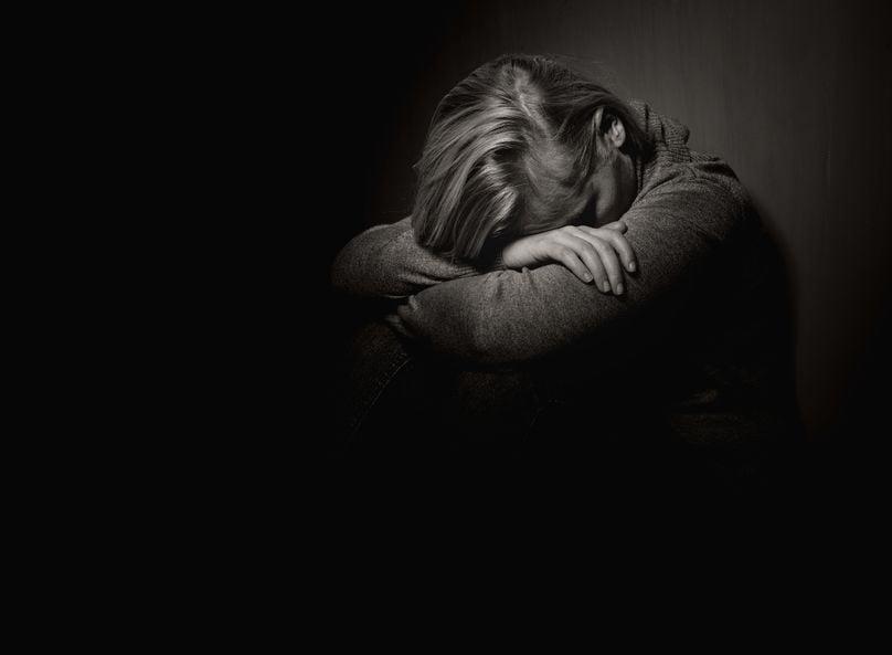 sad woman in shadows