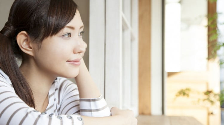 woman smiling at window - mental health story