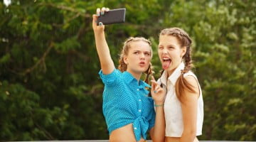 young people (girls) taking selfie
