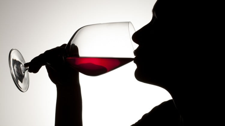 silhouette of person drinking wine
