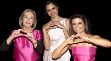 Priceline Sisters make hearts with hands