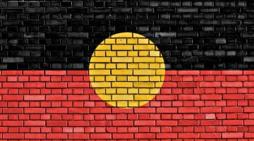 Aboriginal flag painted on bricks