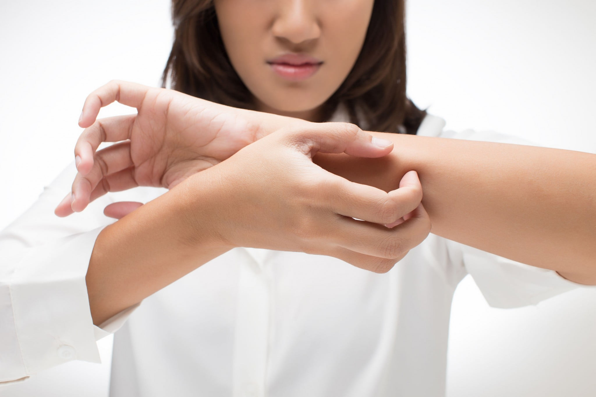 woman scratching arm - skin allergy