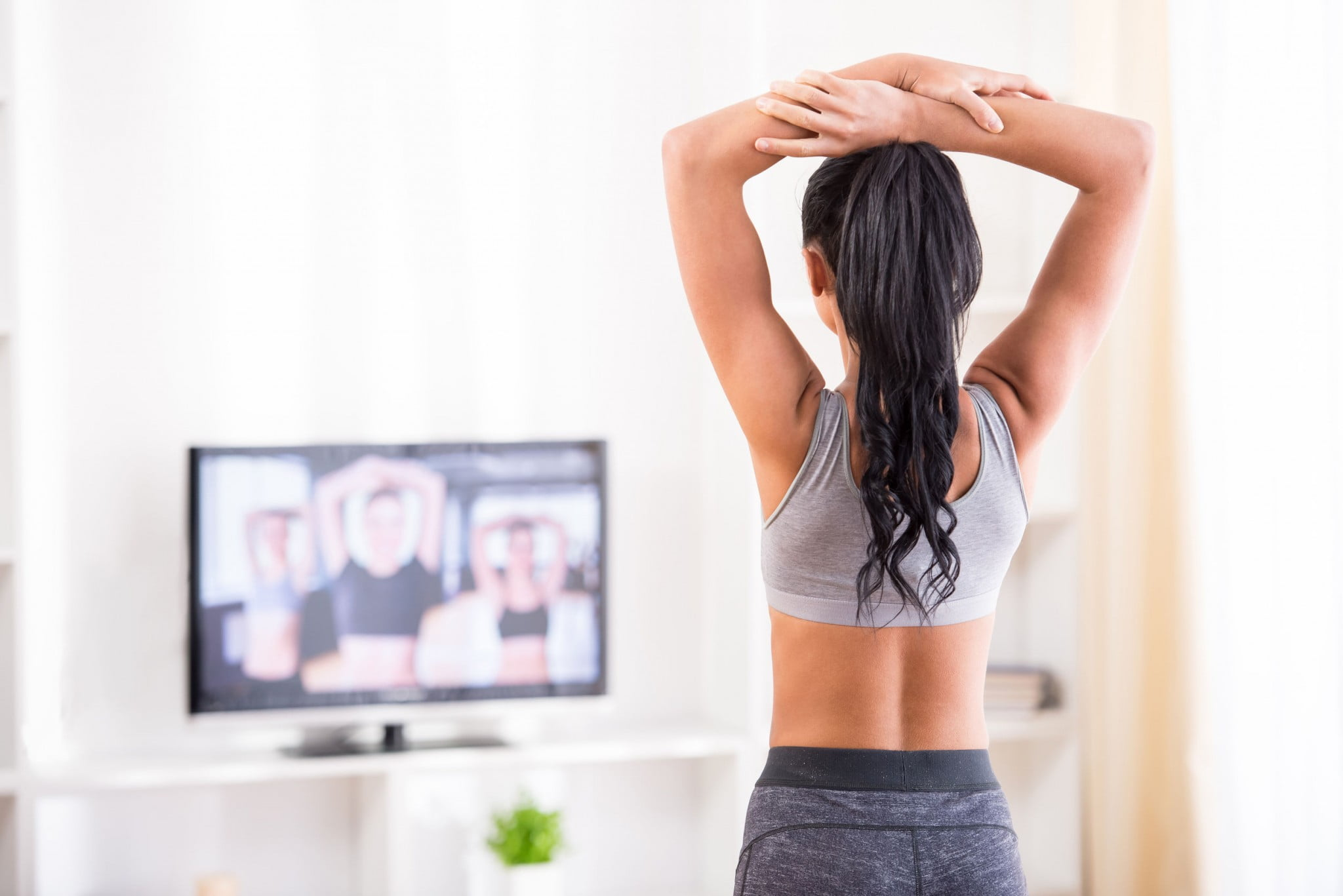 woman in front of tv
