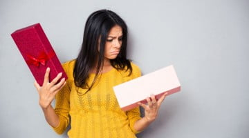 Woman opens Christmas gift and is unimpressed