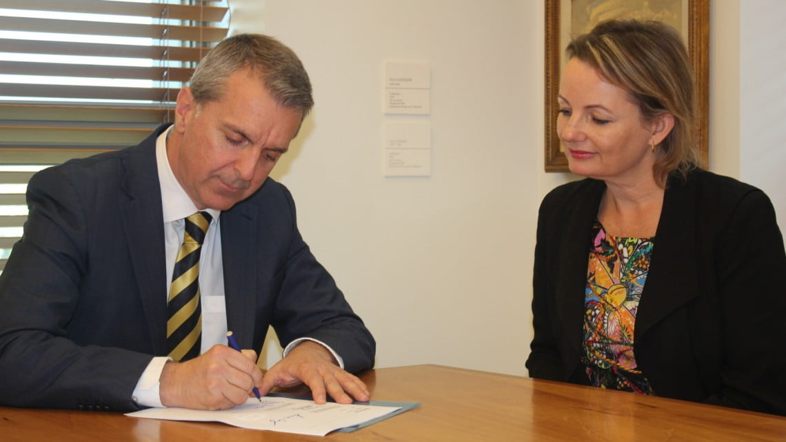 George Tambassis and Sussan Ley sign the 6CPA