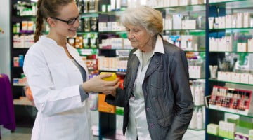 health services: pharmacist talks to patient