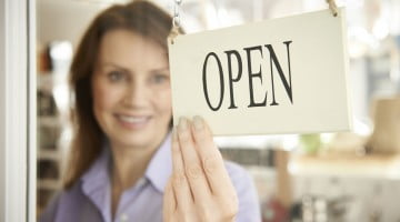 "Shop with ""open"" sign at door - business confidence"