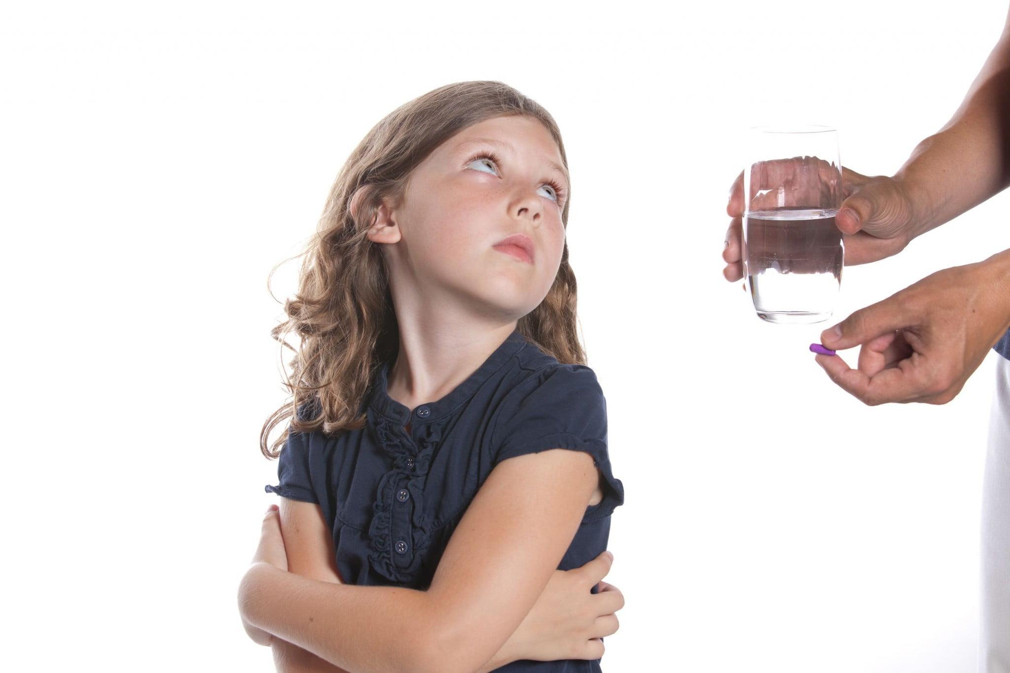 children health: little girl refuses medicine
