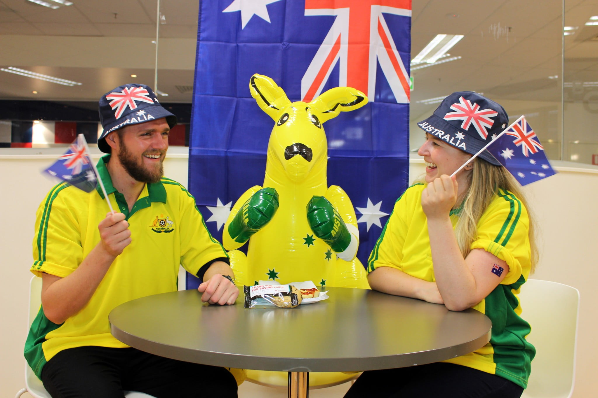 Bleed for Australia, donors in green and gold with inflatable kangaroo waving flags