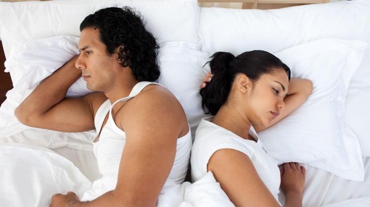 angry couple sleep back to back