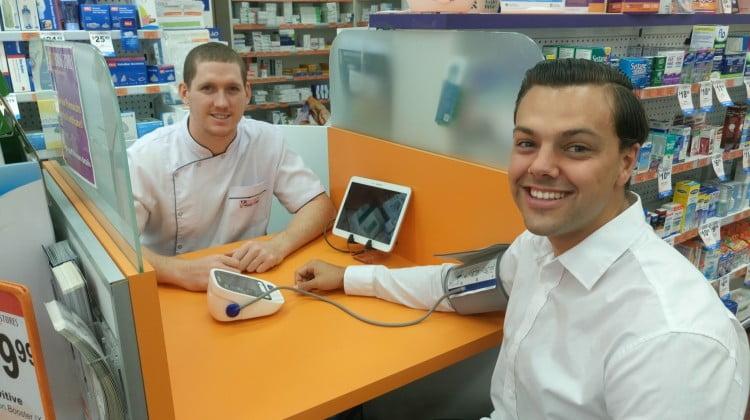 pharmacist Jack Clark offers customers screening assessments for chronic illness
