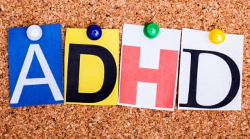 """""""adhd"""" letters on corkboard"""
