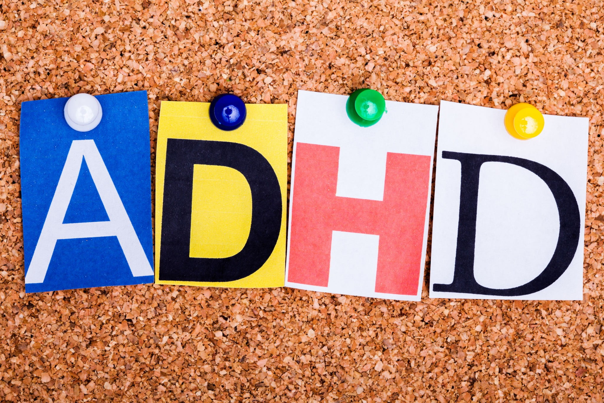 """adhd"" letters on corkboard"