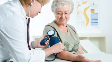 senior woman having blood pressure check