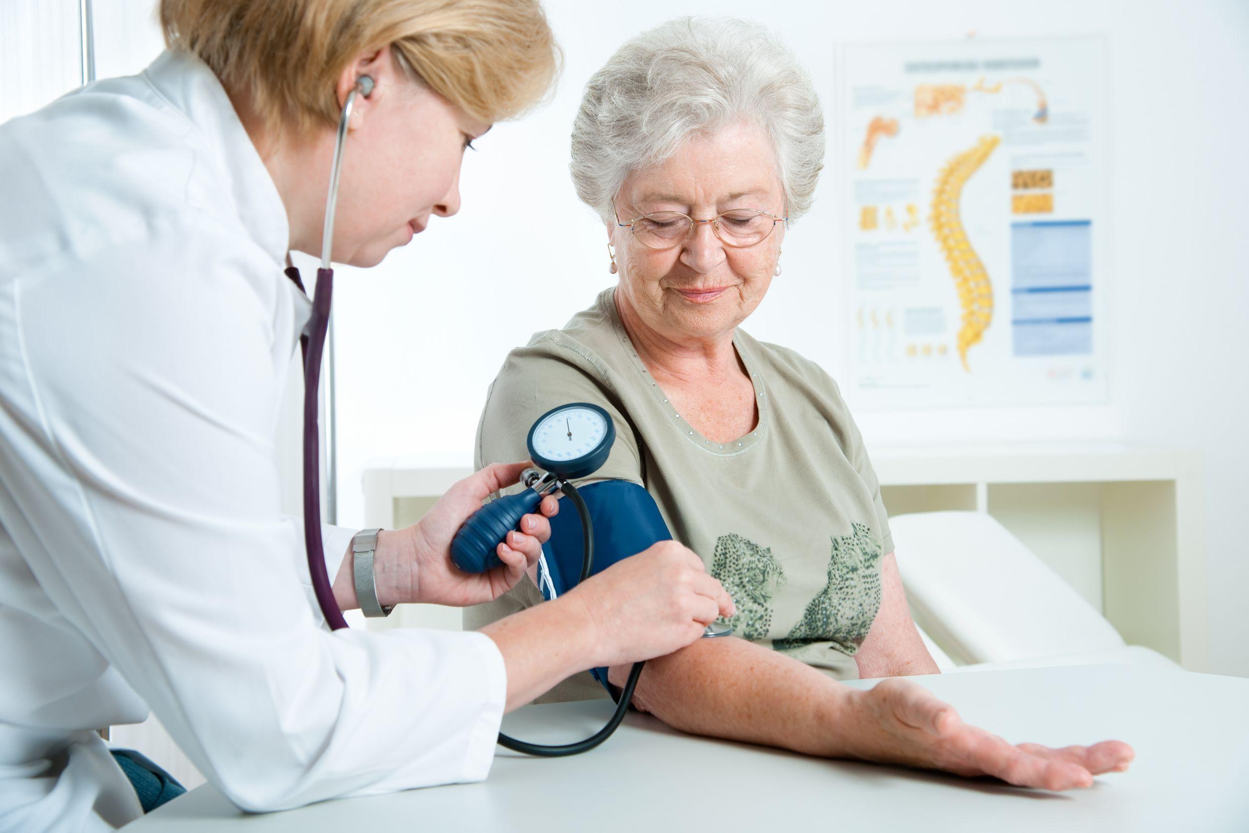 senior woman having blood pressure check