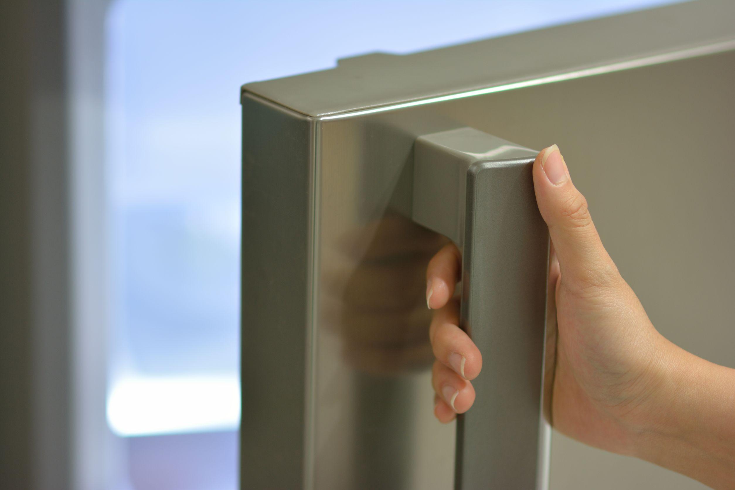 hand opening fridge door