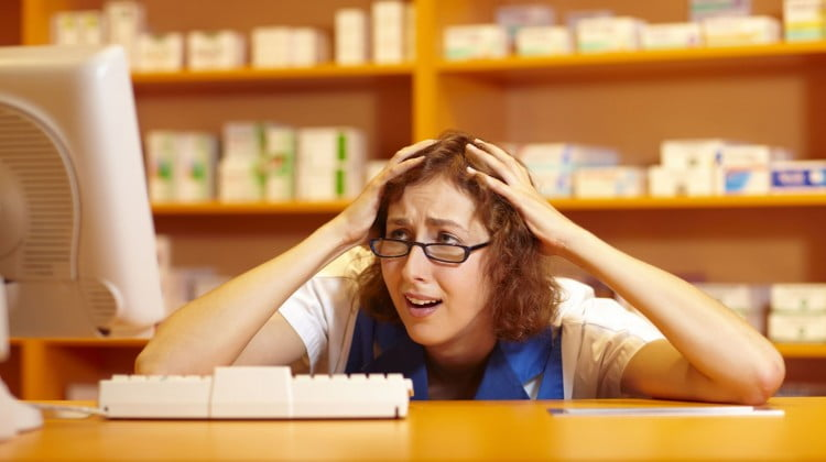 Stressed pharmacist in dispensary