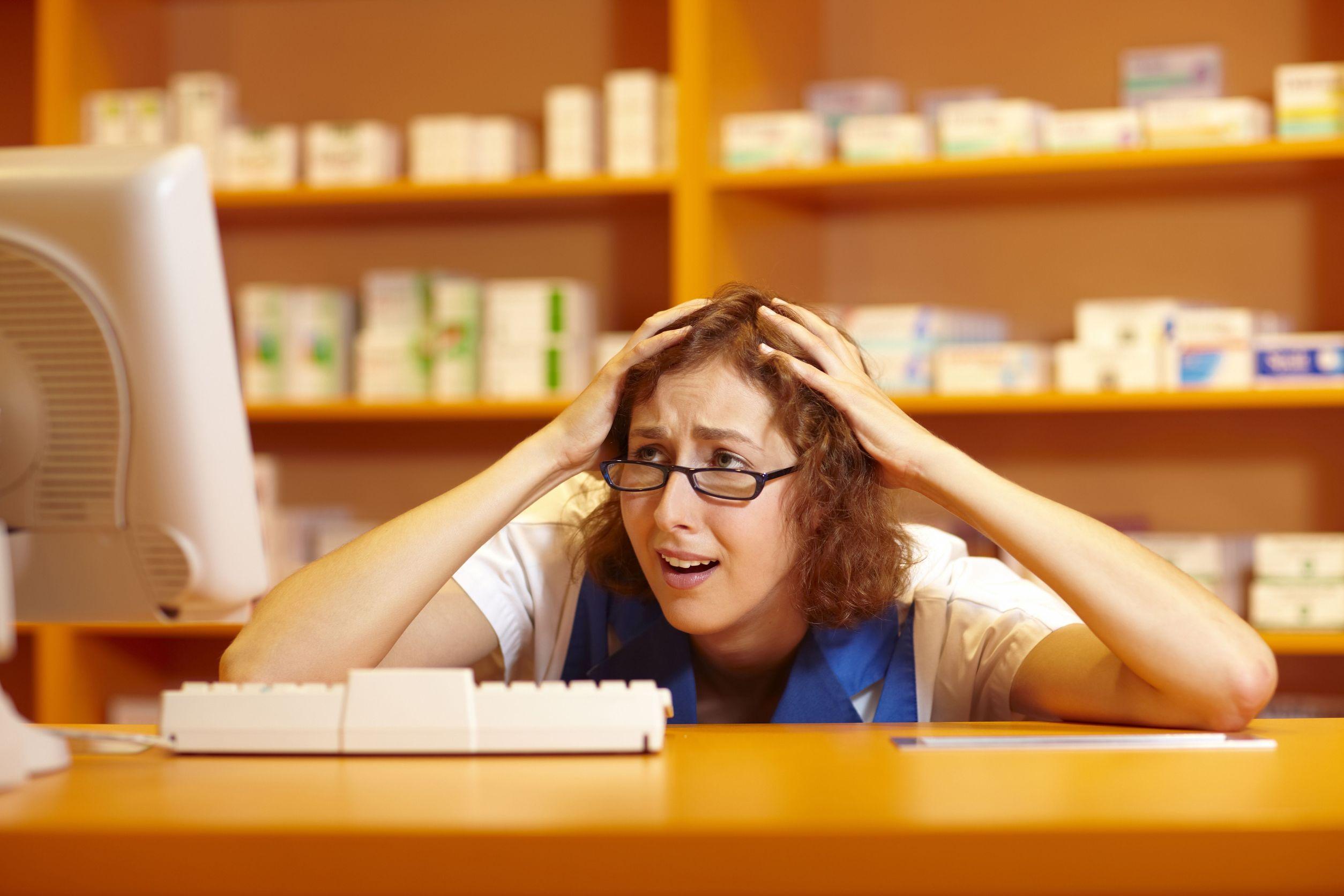 Stressed pharmacist in dispensary