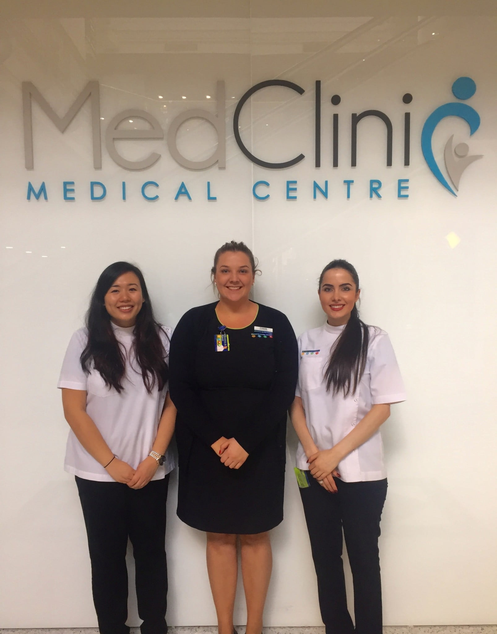 (right, with retail manager Cassie Elvy, centre, and pharmacist Jacquie Trinh)