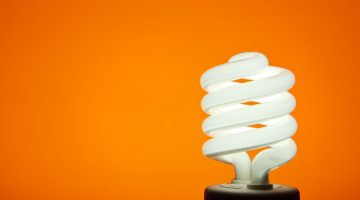 smart light bulb on orange background