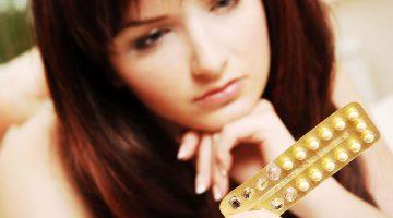 woman looking at birth control