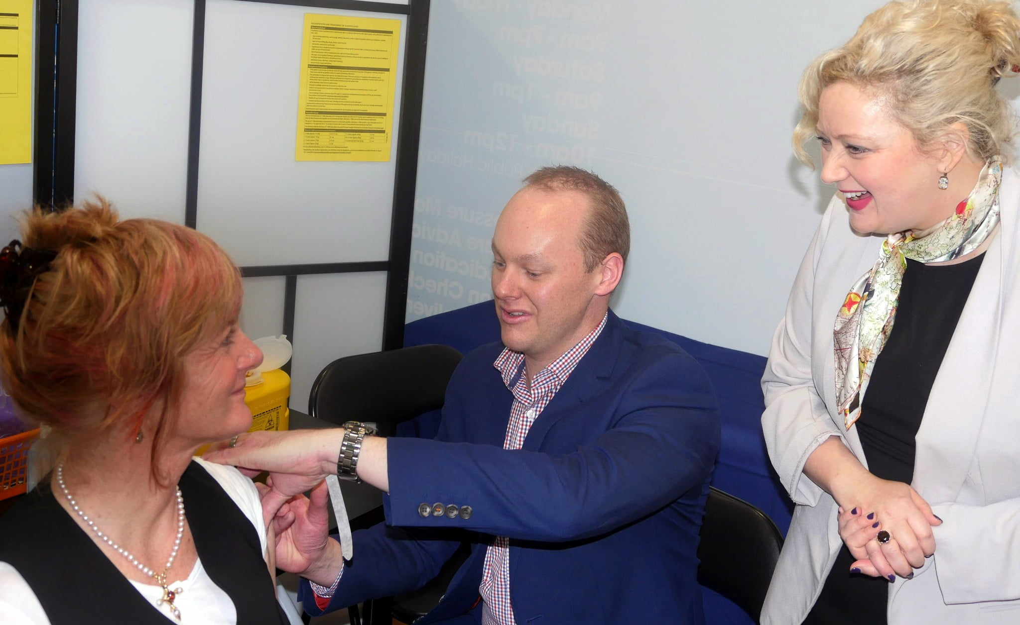 PSA Victorian Branch President Ben Marchant administers the first vaccination by a pharmacist to new grandma Kathleen Philip in Melbourne today watched on by Victorian Health Minister Jill Hennessy MP.