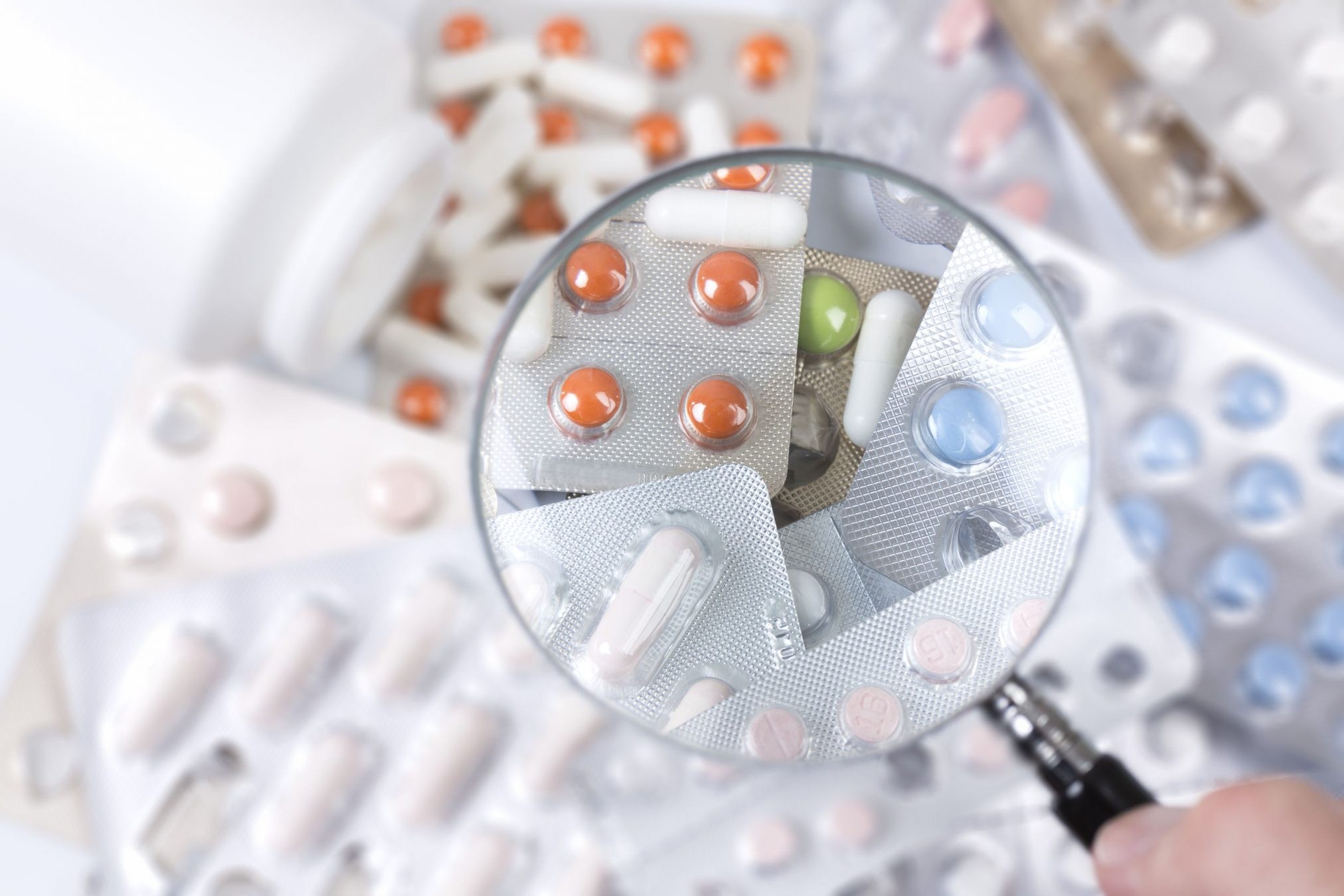 medicines under magnifying glass