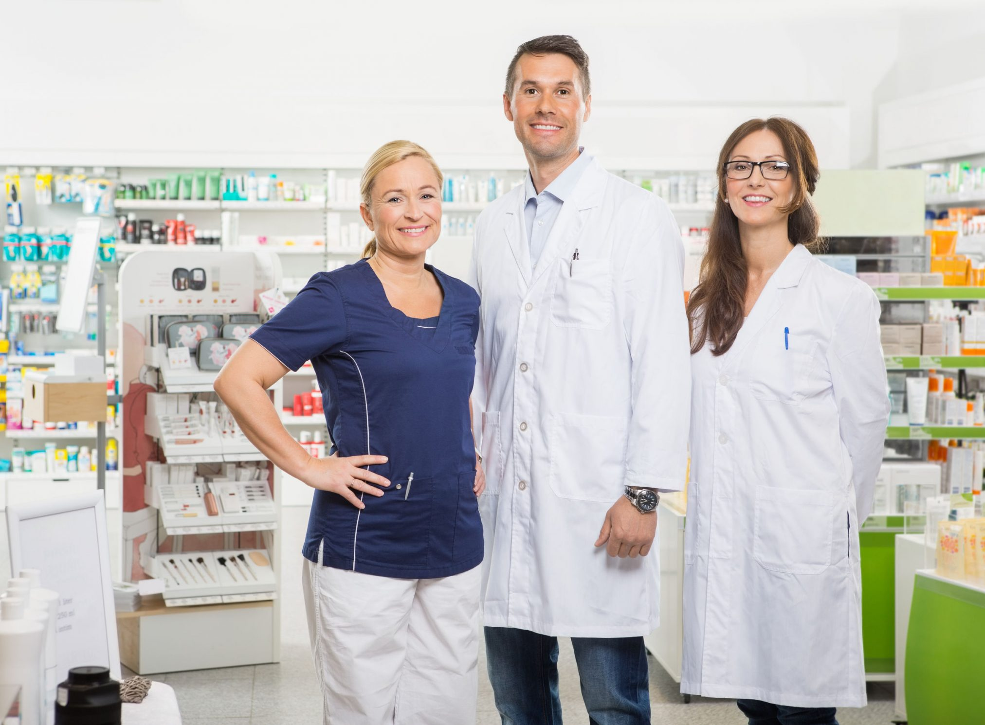 pharmacists standing in pharmacy