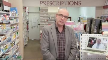 Julian Morrow interviews Ian Carr in a pharmacy
