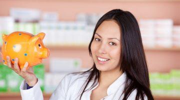 pharmacist holding piggy bank