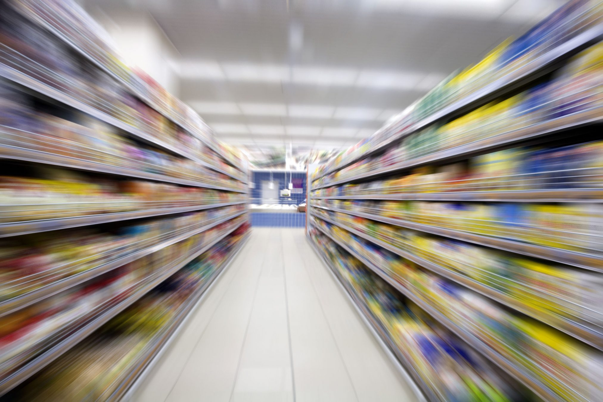 36880436 - empty supermarket aisle,motion blur